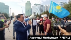 Nurzhan Altaev (with bullhorn) and members of the El Tiregi party rally in Nur-Sultan on September 7.