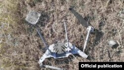 Nagorno-Karabakh - A photograph released by Karabakh Armenian forces purportedly shows a fragment of an Azerbaijani combat drone that attacked one of their positions on August 11, 2021.