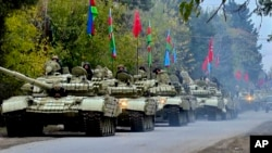 Azerbaijani forces move toward areas in Nagorno-Karabakh that have been handed back to Baku's control.