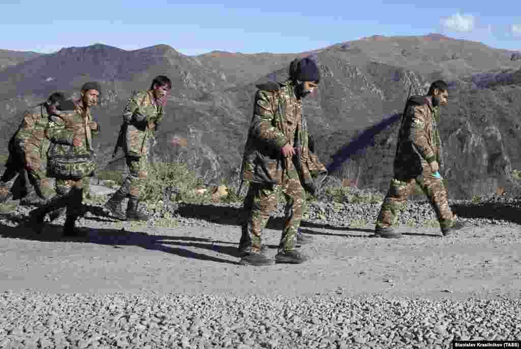 Armenian servicemen in Nagorno-Karabakh walk near the Armenian border on November 8.