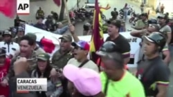 Chavez Supporters Mourn In Streets Of Caracas