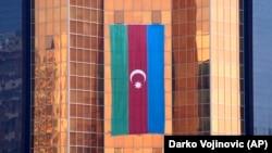 AZERBAIJAN -- A large Azerbaijani flag hangs from a multi-storey office building, in Baku, June 2, 2021