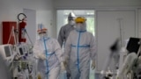 SERBIA -- Intensive care medical workers wearing Personal Protective Equipment (PPE) attend to patients at the Dragisa Misovic hospital intensive care unit in Belgrade, Serbia, 04 May 2020.