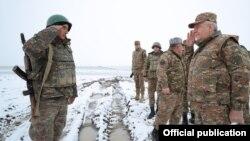 Armenia -- Defense Minister Vagharshak Harutiunian (R) visits a new Armenian army post set up in Syunik province, December 18, 2020.