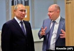 Ruski predsednik Vladimir Putin s metalskim magnatom Vladimirom Potaninom