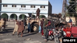 Taliban militants gather after taking control of Lashkar Gah, the provincial capital of Helmand on August 13.