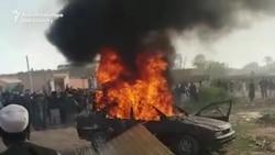 Pakistan Mob Torches Militia Commander's Car, Home