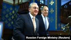 RUSSIA -- Russian Foreign Minister Sergei Lavrov welcomes his Armenian counterpart Zohrab Mnatsakanian (L) during a meeting in Moscow, October 21, 2020