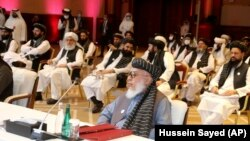 The Taliban delegation attends the opening session of peace talks between the Afghan government and the Taliban in Doha on September 12, 2020.