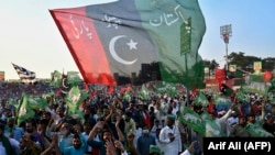 Activists of the Pakistan Democratic Movement rally in the eastern city of Gujranwala on October 16.