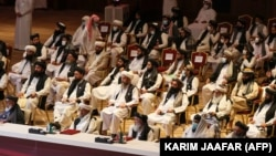 Members of the Taliban delegation attend the opening session of the peace talks between the Afghan government and the Taliban in the Qatari capital, Doha, on September 12, 2020.