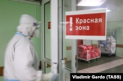 A health-care worker enters the red zone at a Moscow hospital for COVID patients.