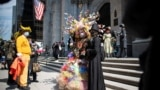 People wearing costumes attend the annual Easter Parade and Bonnet Festival on Fifth Avenue, amid the coronavirus disease (COVID-19) pandemic, in New York City, U.S., April 4, 2021. REUTERS/Eduardo Munoz