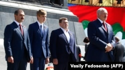 Alyaksandr Lukashenka (right) and his sons (left to right) Viktar, Mikalay, and Dzmitry attend a wreath-laying ceremony marking the 73rd anniversary of the victory over Nazi Germany in Minsk on May 9.