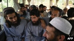 Taliban prisoners await their release from Bagram Prison, north of Kabul, on May 26.