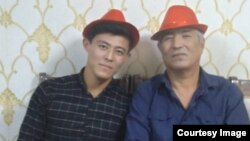 A family photograph of Uzbek opposition activist Khurram Berdiev (right) with his son.