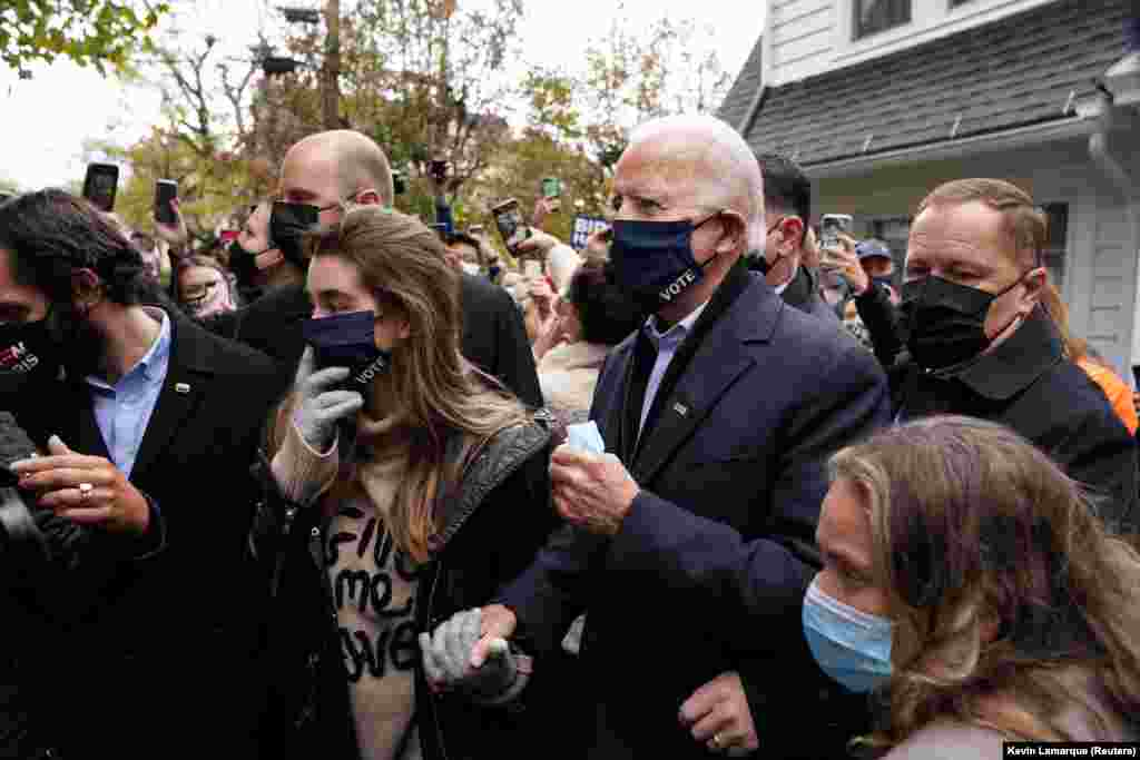 U.S. Democratic presidential nominee Joe Biden makes his way through the crowd outside of his childhood home on Election Day in Scranton, Pennsylvania, U.S. November 3, 2020.