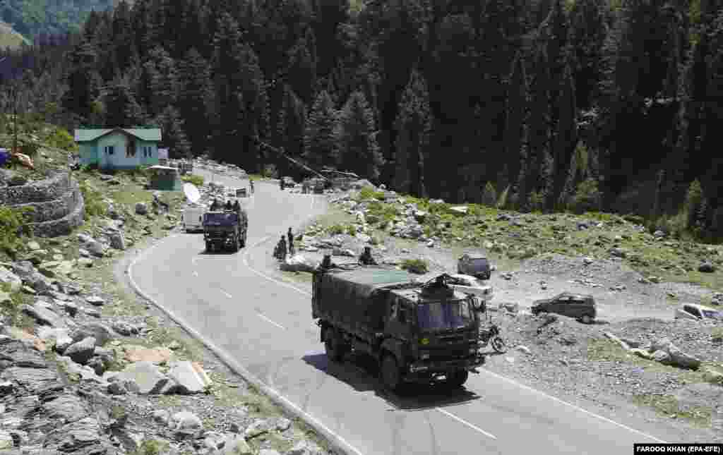 Indian army trucks move along a highway leading to Ladakh, at Gagangeer some 81 kilometers from Srinagar, the summer capital of Indian Kashmir, 17 June 2020.