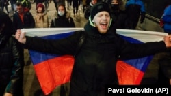 People attend a protest after Russian opposition leader Aleksei Navalny was sentenced to jail in Moscow on February 2.