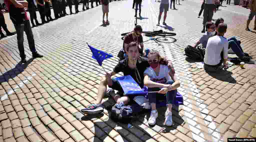 Young people wave EU flags during an anti-government protest in front of parliament in Sofia on July 20. (epa-EFE/Vassil Donev)