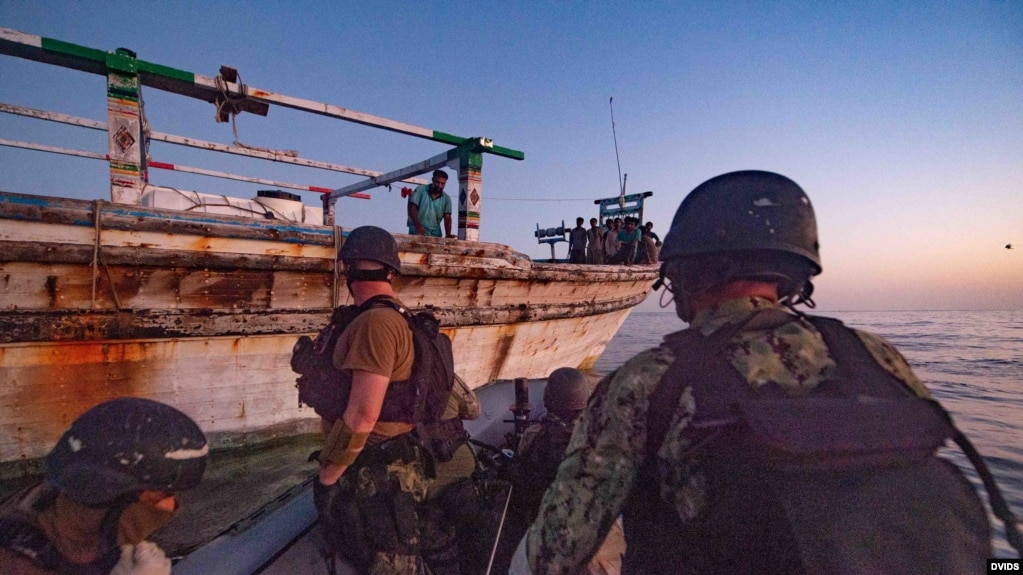 A USS Winston S. Churchill team provides food and water to an Iranian-flagged dhow in distress in the Arabian Sea, Oct. 15.