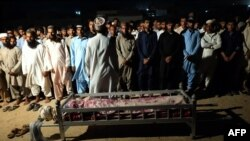 Locals from Gwadar attend the funeral for a victim of the August 20 attack claimed by the Balochistan Liberation Army (BLA).
