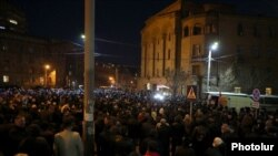 Armenia- Opposition supporters protest outside the Armenian police headquarters in Yerevan , February 23, 2021.