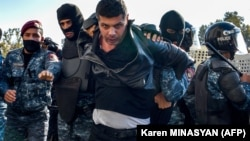 Armenian police detain a protester during an anti-government rally in Yerevan on November 11.