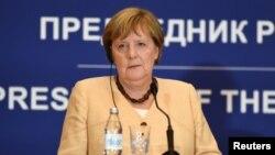 German Chancellor Angela Merkel speaks during a news conference in Belgrade, Serbia.