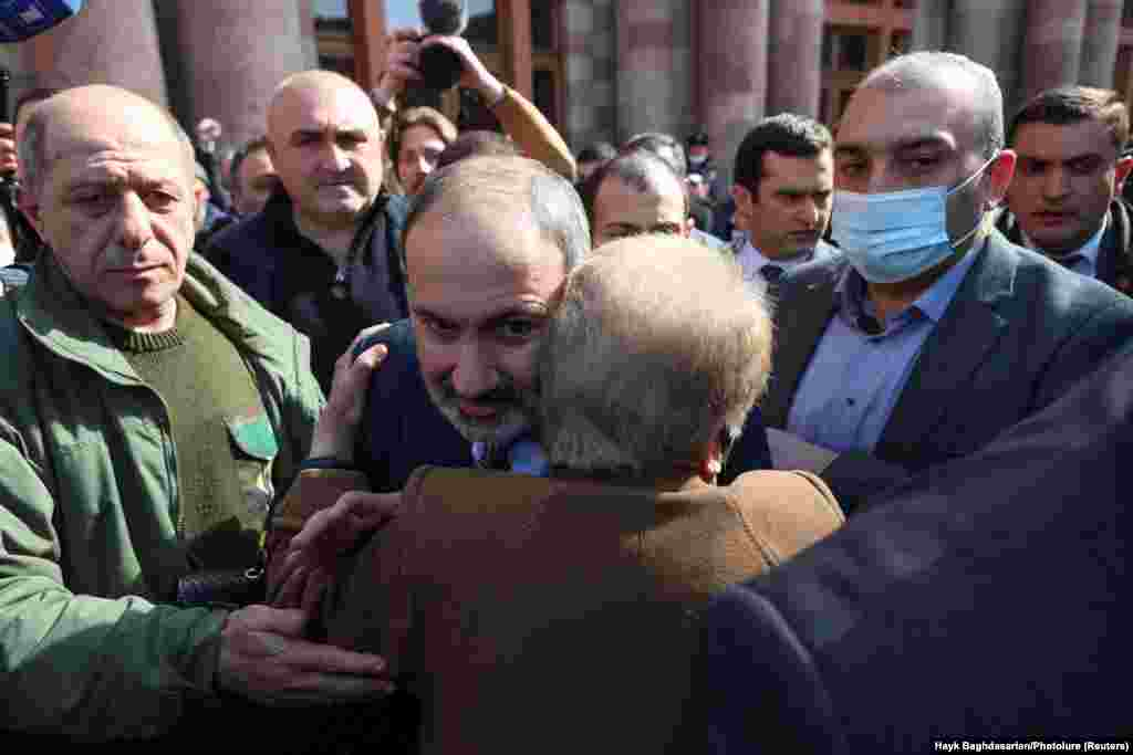 Pashinian hugs a supporter during his march through central Yerevan.