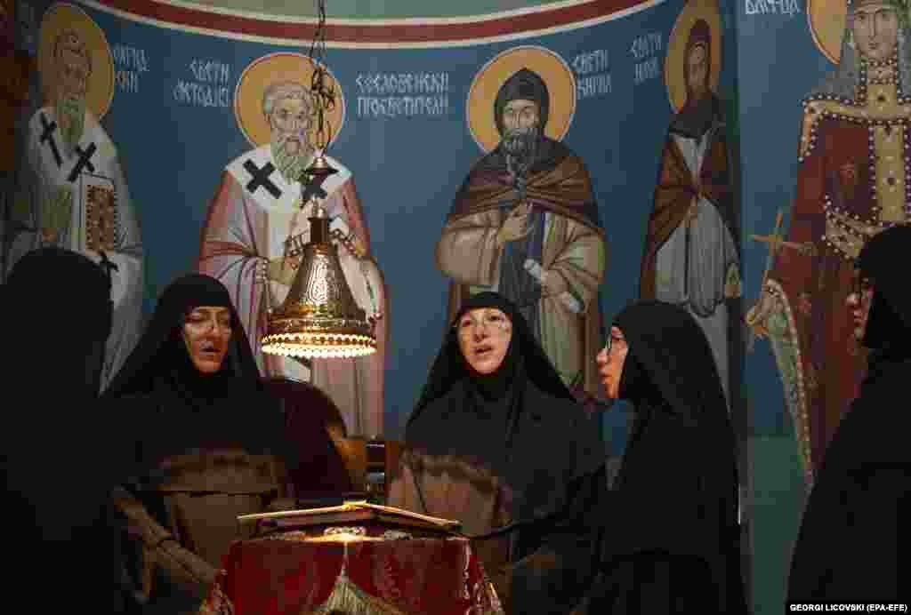 Nuns sing religious songs during morning prayers.