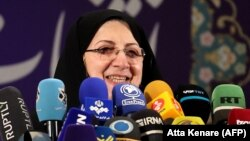 Zahra Shojaei speaks with the press after registering her candidacy earlier this month.
