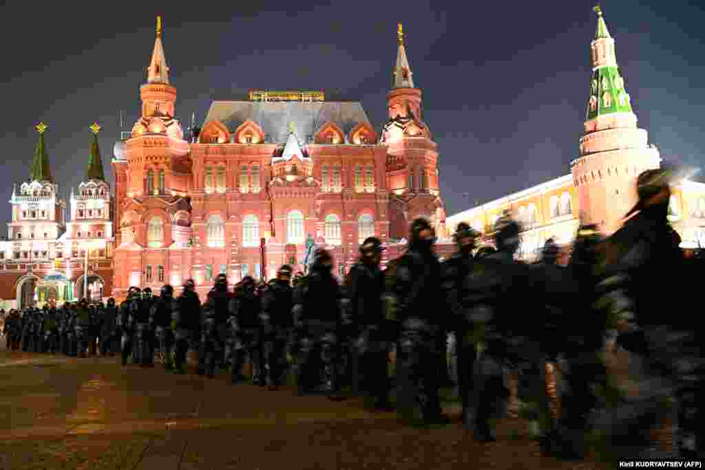 Security forces march through Moscow's Manezh Square.