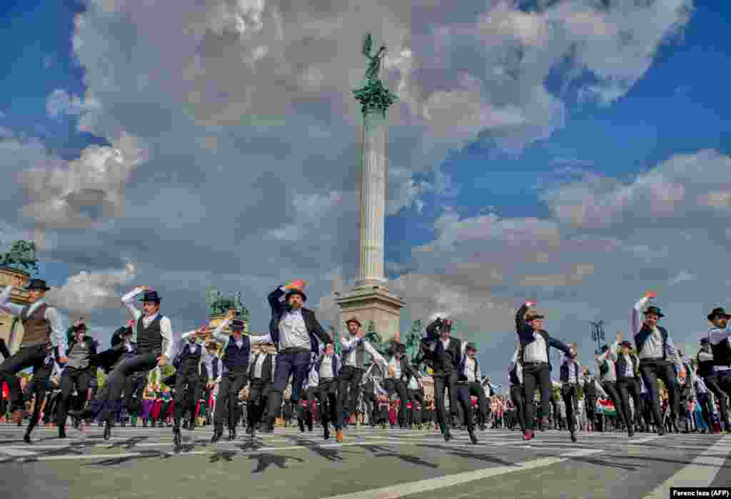 Hungarian folk dancers take part in a World War II memorial event on Heroes Square in Budapest on June 4. (AFP/Ferenc Isza)