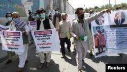 Former Afghan interpreters who worked with U.S. troops in Afghanistan demonstrate in front of the U.S. Embassy in Kabul on June 25.