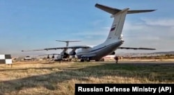 Russian military planes with peacekeepers on board are seen after landing at Erebuni Airport outside Yerevan on November 10.