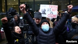 Supporters celebrate in London after the judge's ruling against Assange's extradition on January 4.