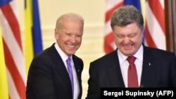 Ukrainian President Petro Poroshenko (right) and U.S. Vice President Joe Biden smile prior to speaking to the press following talks in Kyiv in November 2014.