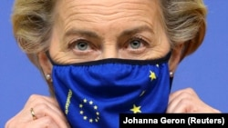 European Commission President Ursula von der Leyen adjusts her mask during a news conference ahead of the second face-to-face EU summit since the coronavirus outbreak, in Brussels on October 1.