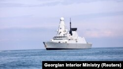 The British Royal Navy warship HMS Defender approaches the Black Sea port of Batumi on June 26.