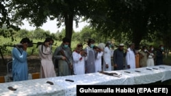 Former Taliban militants surrender their weapons during a reconciliation ceremony in Jalalabad on July 27.