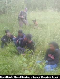 Migrants apprehended on June 22 in a forested border area.