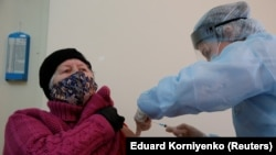 A woman receives an injection with the Sputnik-V vaccine at a hospital in Russia's Stavropol Region.