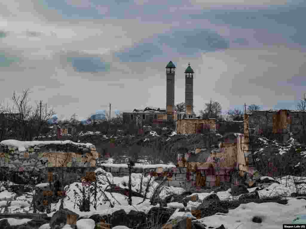 The minarets of the main mosque tower over the rest of the devastated city.