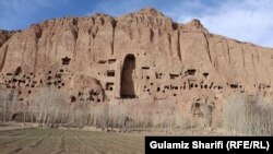 This photo shows dozens of caves and the empty alcove that once housed Solsol, a 55-meter high statue of the Buddha.