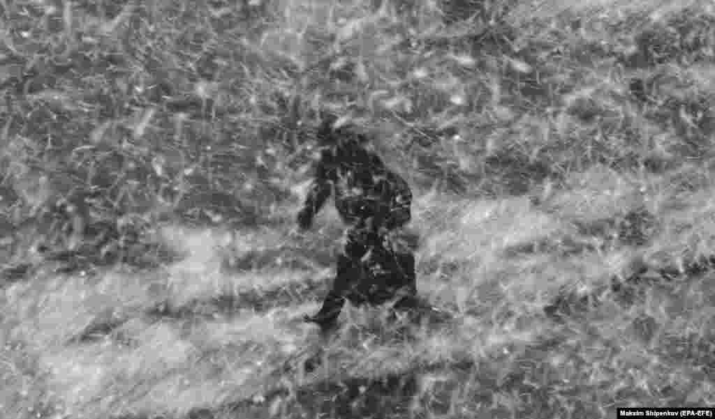 A man walks on the street during a heavy snowfall in Moscow. (epa-EFE/Maksim Shipenkov)