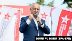 Former Moldovan President Igor Dodon speaks at a campaign rally in Chisinau in the run-up to last weekend's parliamentary elections, which were won by a pro-European grouping founded by the current president, Maia Sandu.
