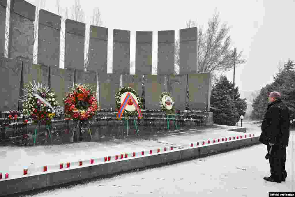 Armenian President Armen Sarkisian at Yerablur cemetery on December 20. Sarkisian has called for early parliamentary elections in response to widespread anger at the government's handling of the conflict and the resulting peace deal.