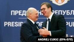 Belarusian President Aleyaksandr Lukashenka (left) is welcomed by his Serbian counterpart, Aleksandar Vucic, on a visit to Belgrade in December.