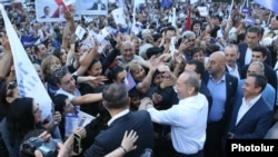 Armenia - Former President Robert Kocharian shakes hands with supporters during an election campaign rally in Yerevan's Nor Nork district, June 9, 2021.